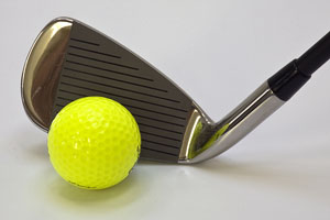 golf club with yellow golf ball